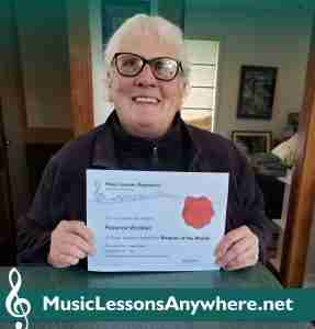 Live online piano student Florence with Student Of The Month music certificate