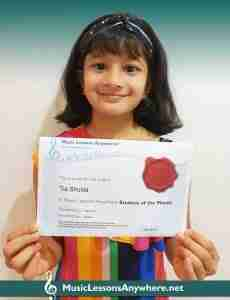 Tia Shukla with certificate - Music Lessons Anywhere music Student of the Month - May 2020