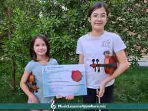 Izabel and Ella with Music Lessons Anywhere Student of the Month certificate May 2021
